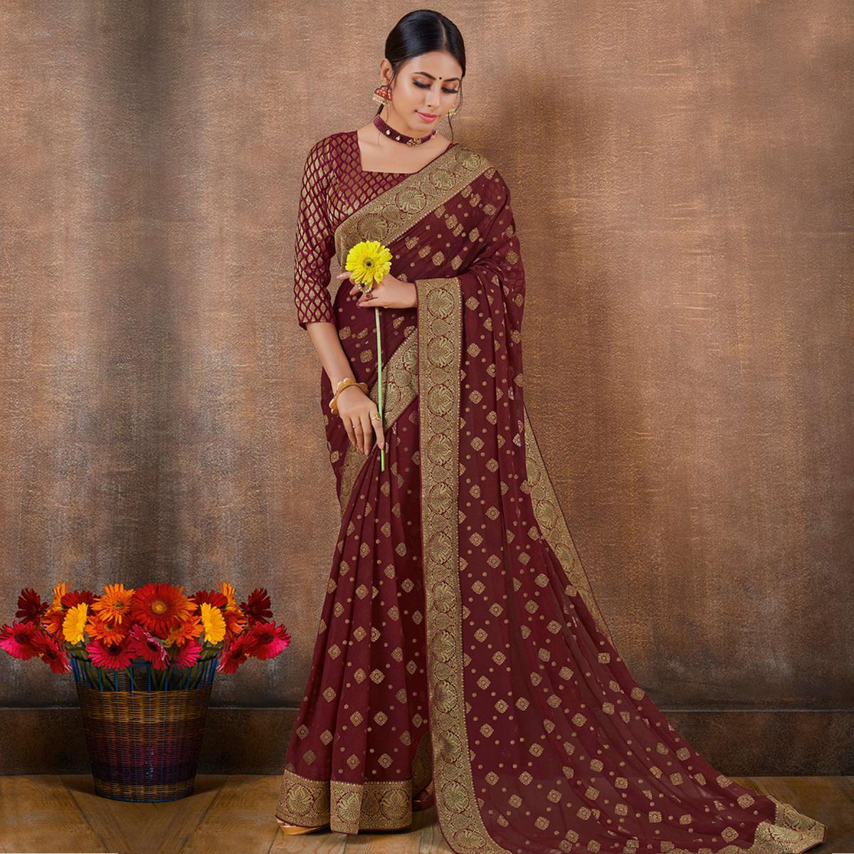 Beautiful Maroon Colored Festive Wear Foil Printed Georgette Saree