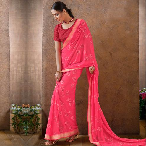 Jazzy Pink Colored Festive Wear Foil Printed Georgette Saree