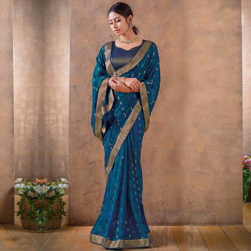 Innovative Blue Colored Festive Wear Foil Printed Georgette Saree