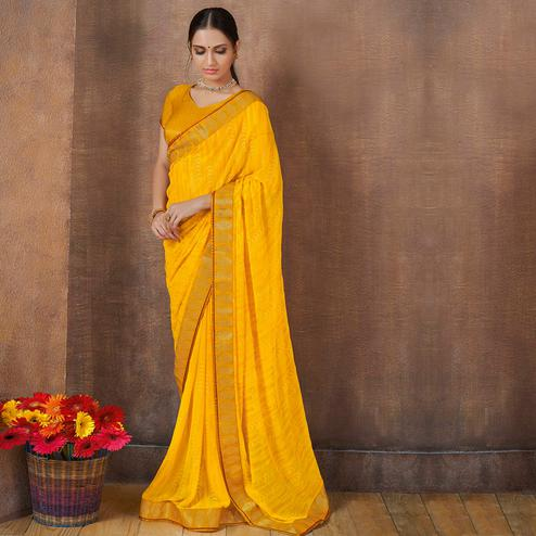 Fantastic Yellow Colored Festive Wear Foil Printed Georgette Saree