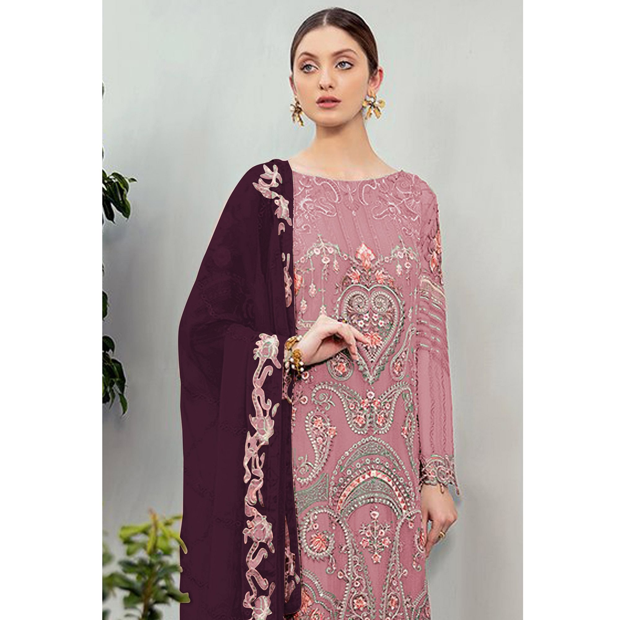 Graceful Pink Colored Partywear Embroidered Georgette Staright Suit