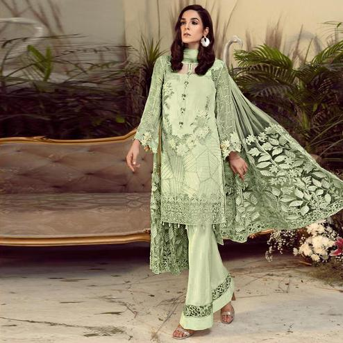 Charming Green Colored Partywear Embroidered Faux Gerogette Straight Suit