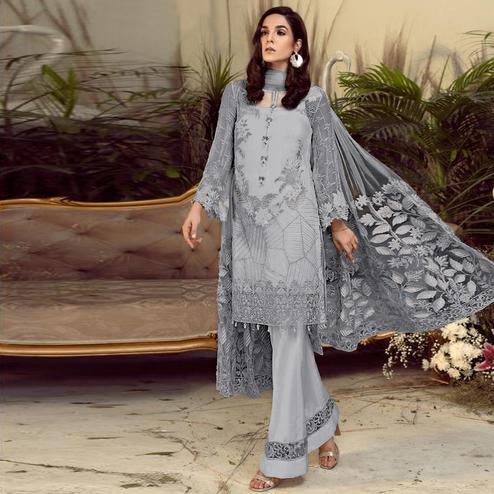 Jazzy Grey Colored Partywear Embroidered Faux Gerogette Straight Suit
