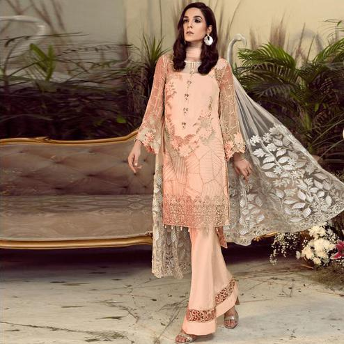 Delightful Peach Colored Partywear Embroidered Faux Gerogette Straight Suit