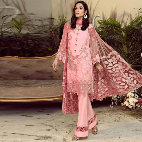 Engrossing Pink Colored Partywear Embroidered Faux Gerogette Straight Suit