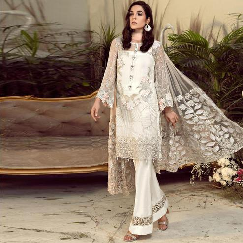 Captivating Offwhite Colored Partywear Embroidered Faux Gerogette Straight Suit