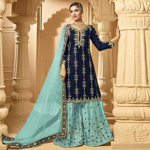 Innovative Navy Blue Colored Partywear Embroidered Faux Georgette Palazzo suit
