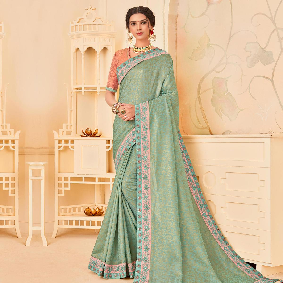 Desirable Turquoise Colored Festive Wear Woven Poly Silk Saree