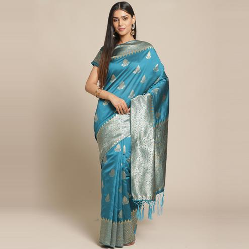 Charming Teal Blue Colored Festive Wear Woven Silk Saree