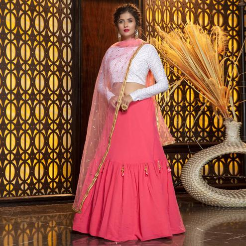 Energetic Pink Colored Partywear Foil Printed Georgette Lehenga Choli