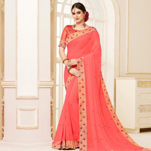 Indian Women Pink Colored Festive Wear Woven Georgette Saree