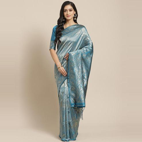 Gorgeous Teal Blue Colored Festive Wear Woven Silk Blend Saree