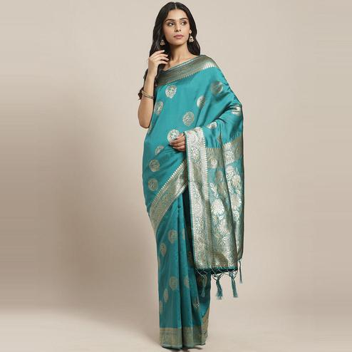Impressive Teal Green Colored Festive Wear Woven Silk Blend Saree