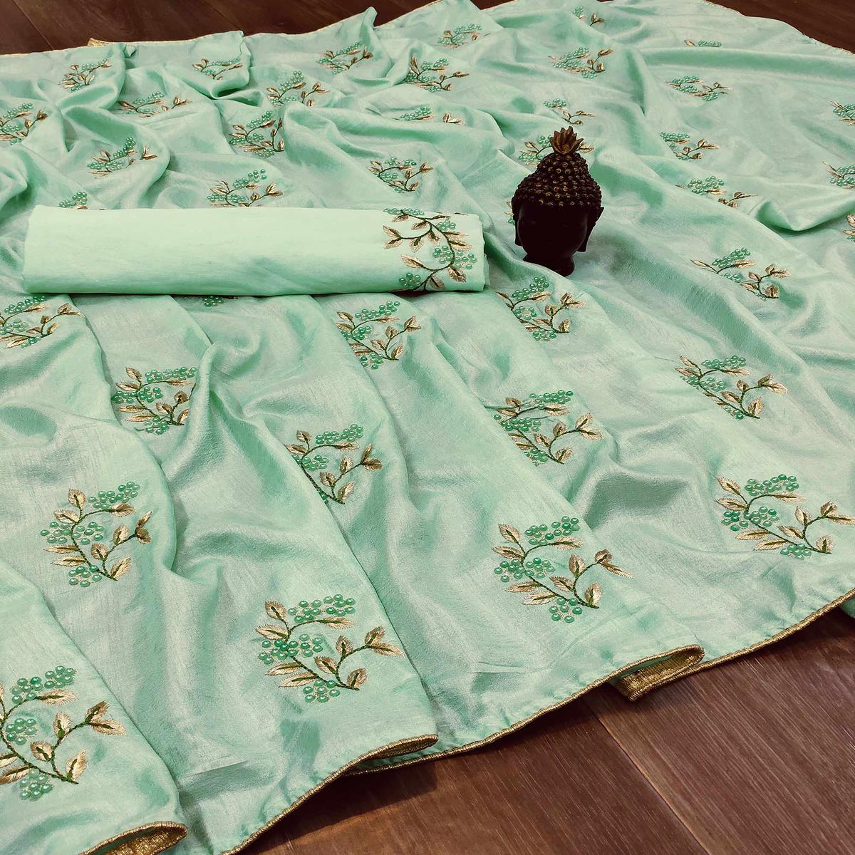 Sophisticated Turquoise Green Colored Festive Wear Woven Dola Silk Saree