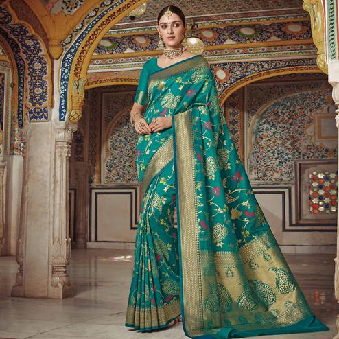 Refreshing Turquoise Green Colored Festive Wear Woven Soft Silk Saree
