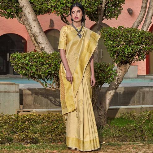 Flamboyant Cream Colored Festive Wear Woven Silk Saree