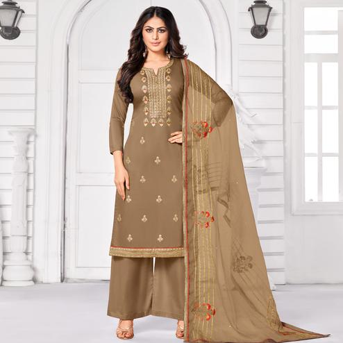 Stunning Light Brown Colored Partywear Embroidered Pure Jam Cotton Dress Material
