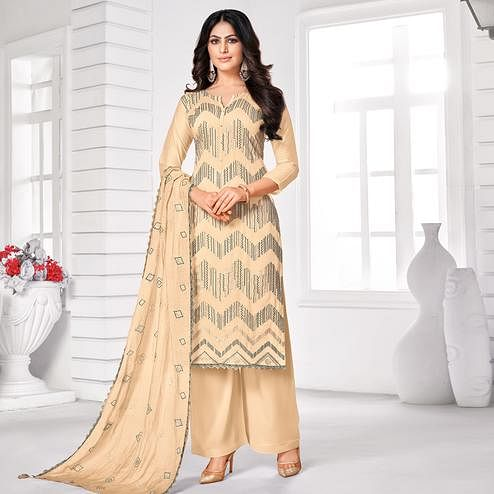 Classy Beige Colored Partywear Embroidered Pure Jam Cotton Dress Material