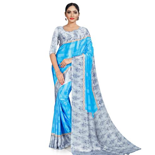Pleasant Sky Blue Colored Casual Wear Printed Crepe Saree