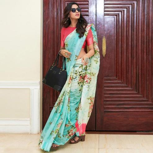 Intricate Aqua Blue Colored Casual Wear Floral Printed Linen Saree
