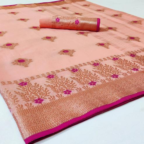 Lovely Peach Colored Festive Wear Woven Linen Saree