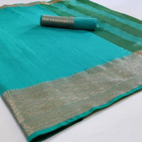 Mesmeric Turquoise Blue Colored Festive Wear Woven Silk Saree