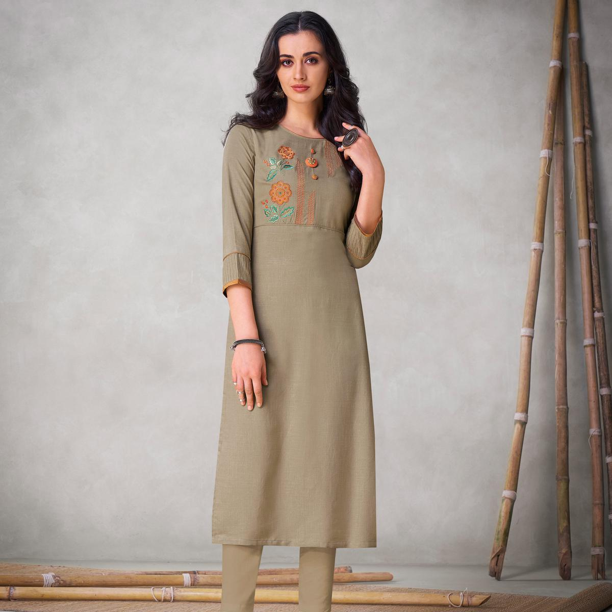 Lovely Beige Colored Partywear Embroidered Viscose Kurti