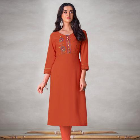 Majesty Orange Colored Partywear Embroidered Viscose Kurti