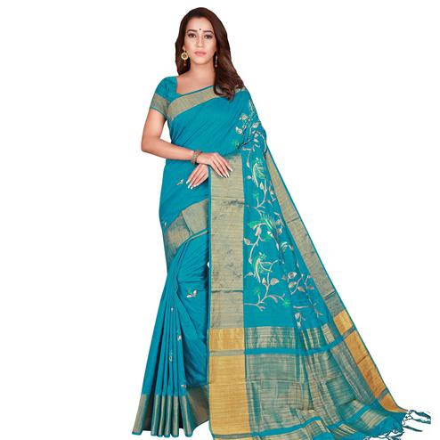 Gleaming Turquoise Blue Colored Festive Wear Woven Silk Saree