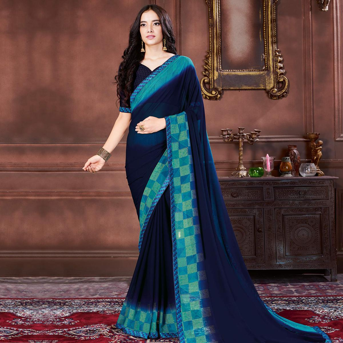 Classy Navy Blue Colored Casual Wear Printed Heavy Georgette Saree