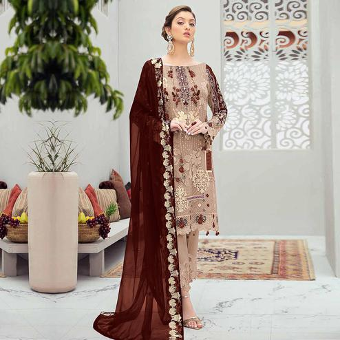 Intricate Beige Colored Partywear Embroidered Net Straight Suit