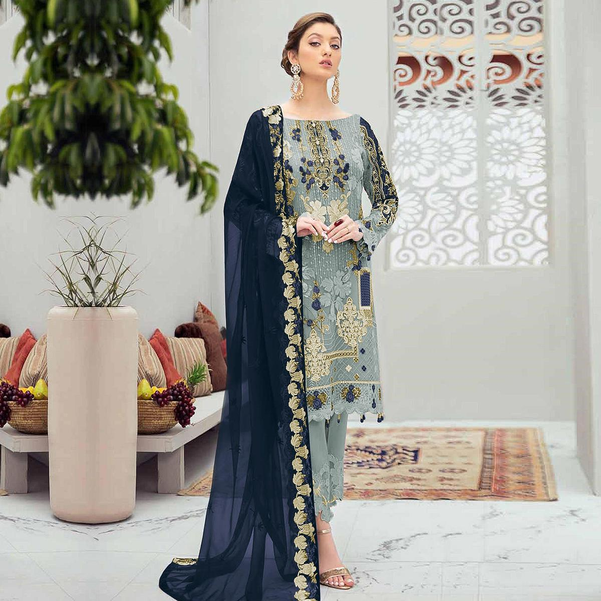 Desirable Grey Colored Partywear Embroidered Net Straight Suit