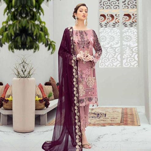 Exotic Pink Colored Partywear Embroidered Net Straight Suit