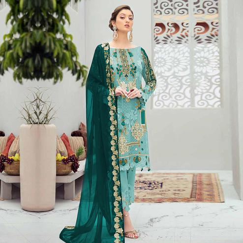 Sophisticated Aqua Blue Colored Partywear Embroidered Net Straight Suit