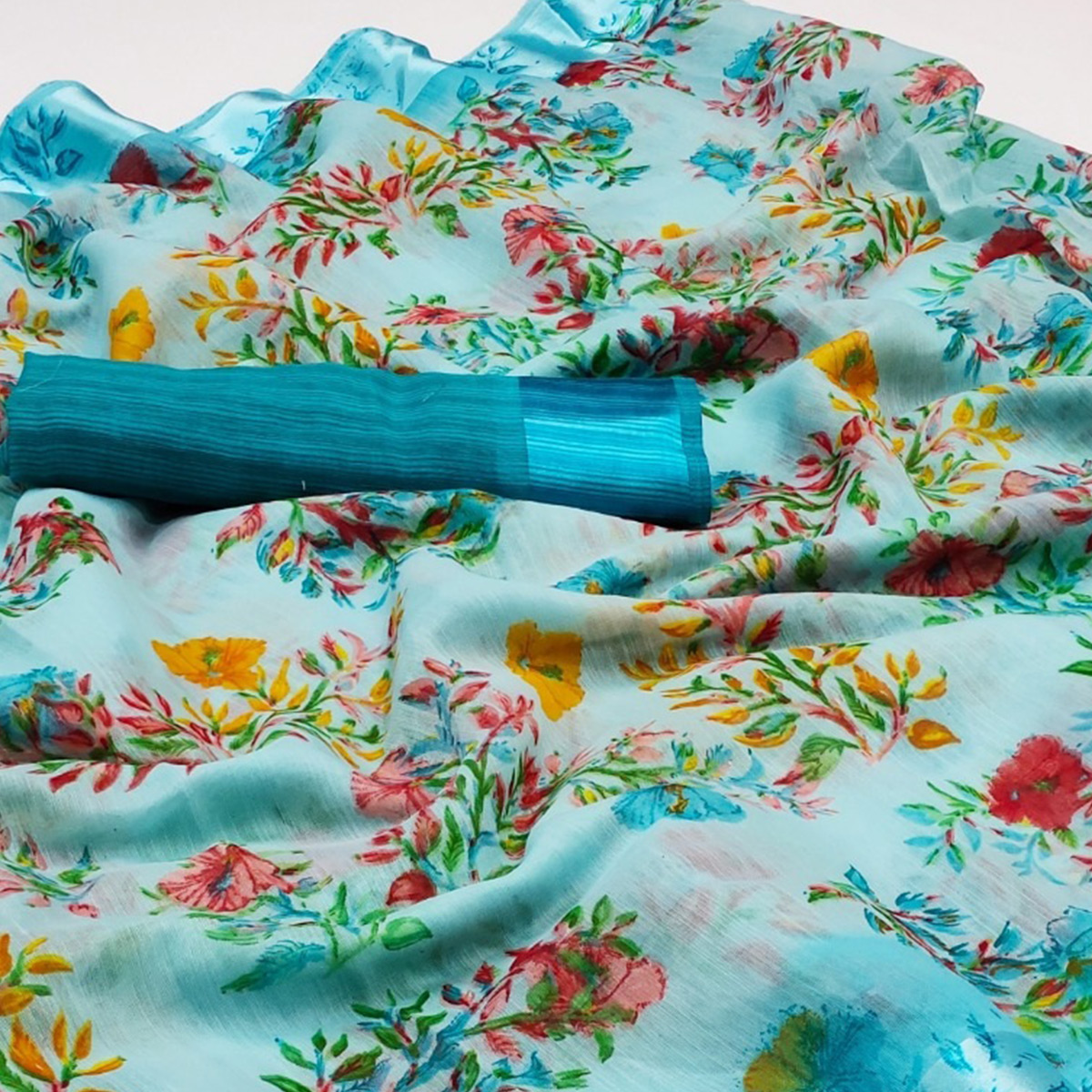 Flamboyant Sky Blue Colored Casual Wear Floral Printed Cotton Linen Saree
