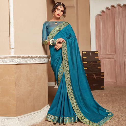 Charming Turquoise Blue Colored Festive Wear Woven Vichitra Silk Saree