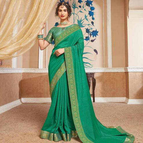 Delightful Green Colored Festive Wear Woven Vichitra Silk Saree