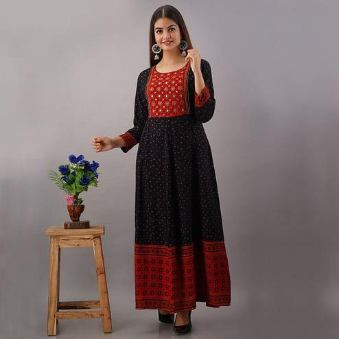 Surpassing Black Colored Partywear Mirror Work Rayon Long Kurti