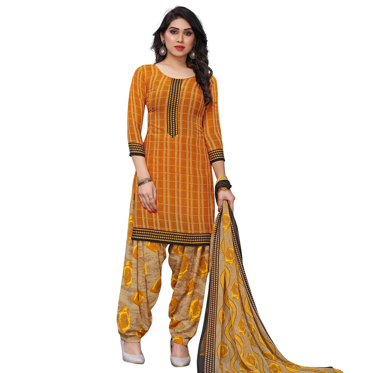 Ravishing Yellow Colored Casual Wear Printed French Crepe Patiala Dress Material