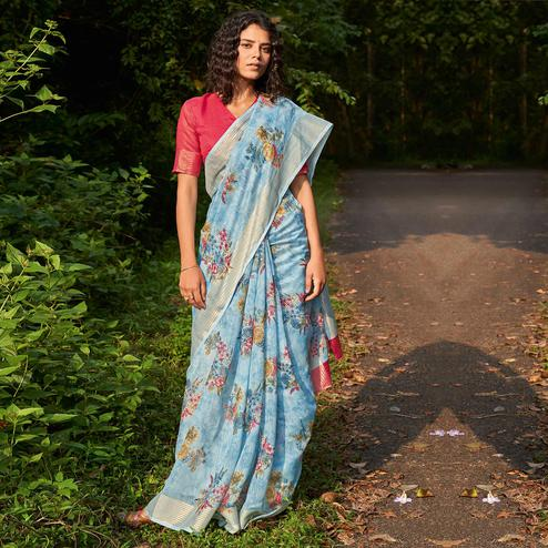 Lovely Light Blue Colored Partywear Floral Printed Fancy Linen Saree