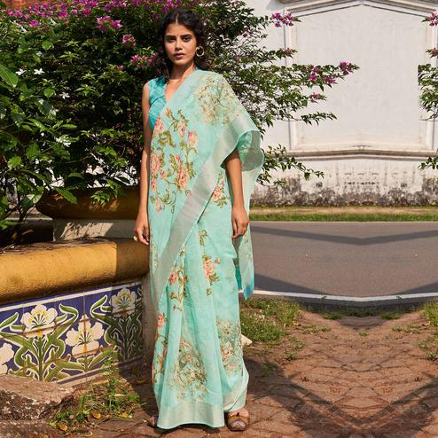 Breathtaking Pastel Blue Colored Partywear Floral Printed Fancy Linen Saree