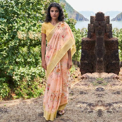 Dazzling Light Peach Colored Partywear Floral Printed Fancy Linen Saree