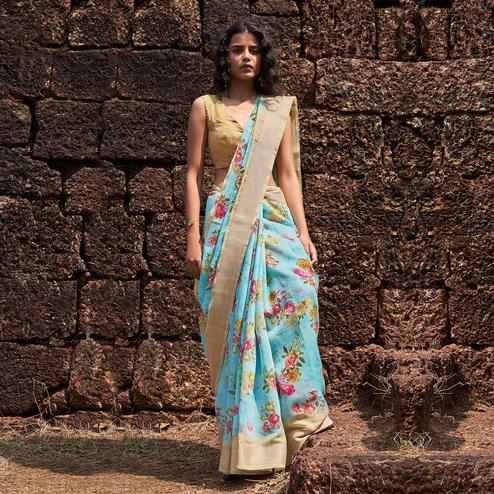 Intricate Blue Colored Partywear Floral Printed Fancy Linen Saree