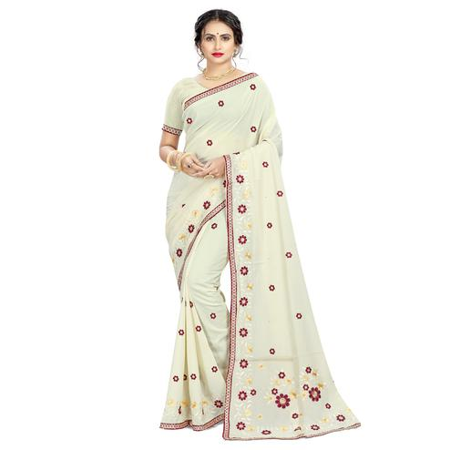 Prominent Offwhite Colored Casual Wear Embroidered Crepe Saree
