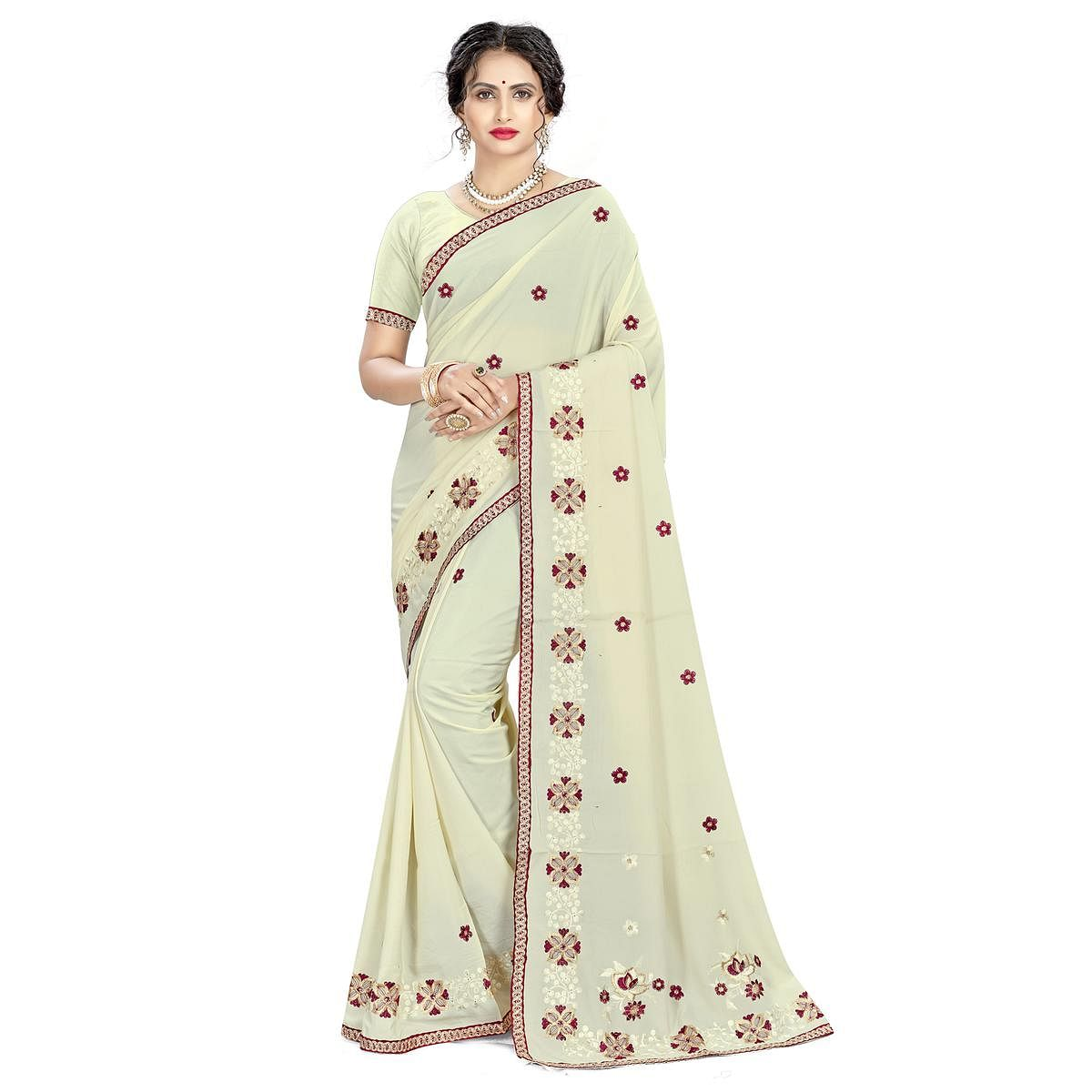 Entrancing Cream Colored Casual Wear Embroidered Crepe Saree