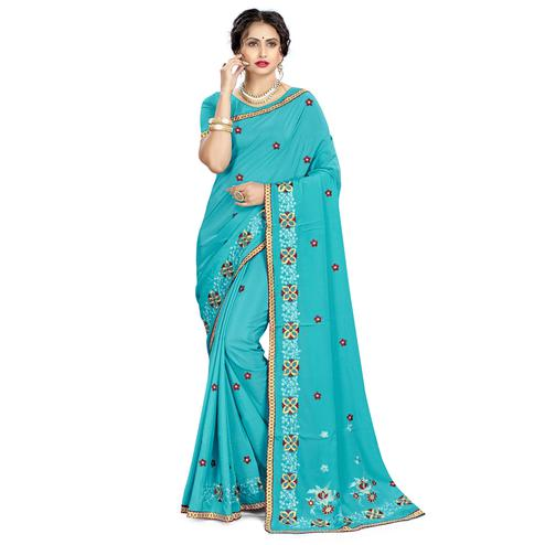 Groovy Blue Colored Casual Wear Embroidered Crepe Saree