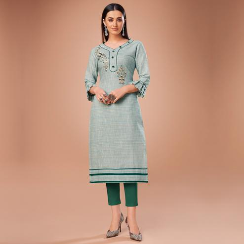 Flattering Light Blue Colored Partywear Embroidered Cotton Kurti