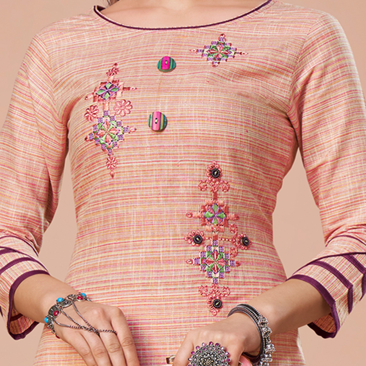 Excellent Peach Colored Partywear Embroidered Cotton Kurti