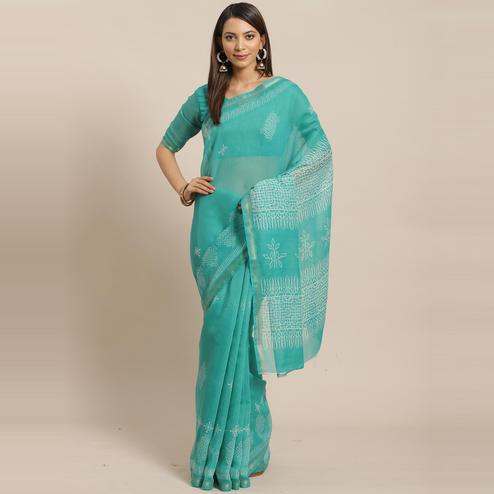 Gleaming Sea Green Colored Casual Wear Printed Silk Blend Saree