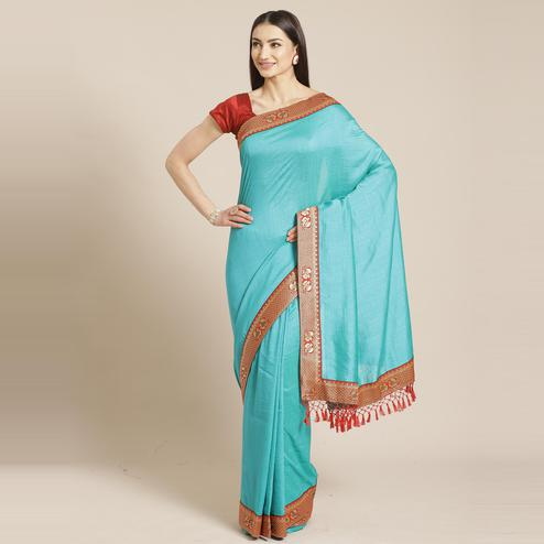 Pretty Sea Green Colored Festive Woven Silk Blend Saree
